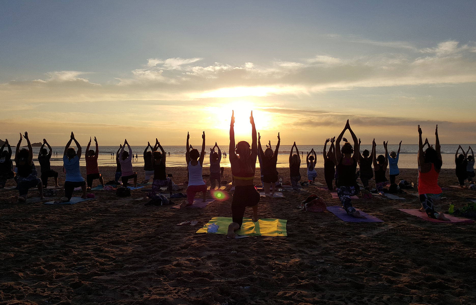 Silent Disco Yoga on Brighton and Hove Beach in West Sussex, UK